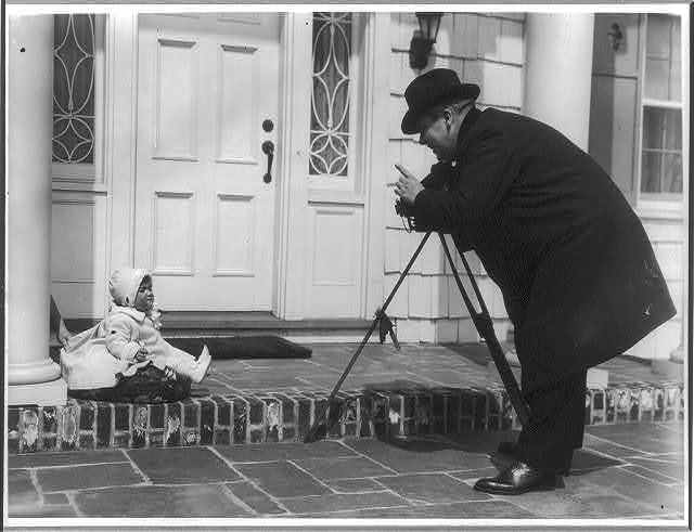 Babies and child care - photographing the baby (Mr. Burr) [on porch]
