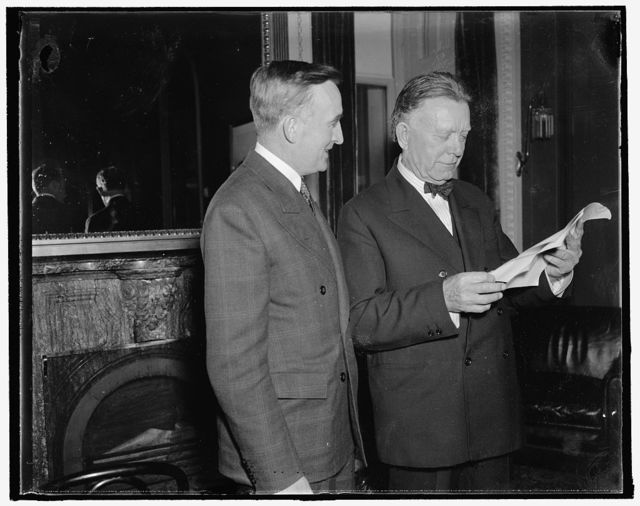 Back Senate bills proposing licensing of corporations operating in interstate commerce. Washington, D.C., Nov. 26. Both Senators Joseph A. O'Mahoney (left) of Wyoming, and William E. Borah, of Idaho, have introduced bills in the Senate requiring that corporations which operate in interstate commerce take out federal charters. The bills are aimed to reach objectives of NRA and the pending Wage-Hour Bill--that is, fair-trade practices in industry and protection of the worker from over-long hours and oppressive wages--but in a simpler fashion. Senators Borah and O'Mahoney are seeking agreement on the form of a bill, with the aim, if possible, of merging their individual measures, 11/26/37