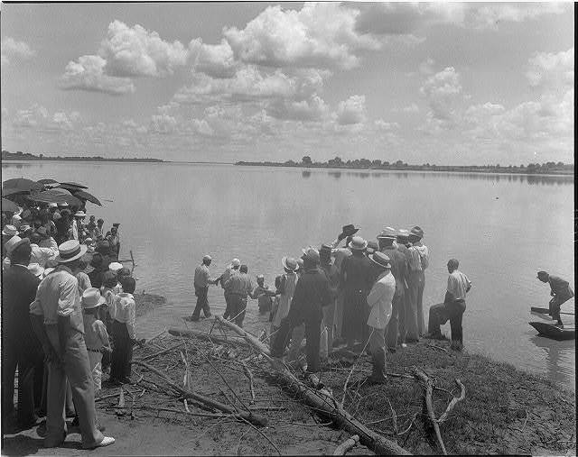 [Baptism by immersion in the MIssissippi River, May 29, 1938: ankle-deep in water]