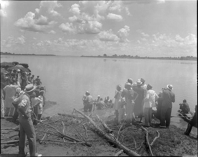 [Baptism by immersion in the MIssissippi River, May 29, 1938: shoulder-deep in water]