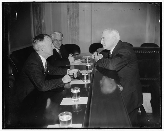 """Baruch quizzed by Senate Committee. Washington, D.C., Feb. 28. Senator James F. Byrnes, (left) Chairman of the Senate Unemployment and Relief Committee, questioning Bernard Baruch, voted Financier today. Baruch declared America must make a choice between the """"proof of its system and the hope of gain"""" and the """"the new European ideas of state regulation and fear of punishment"""""""