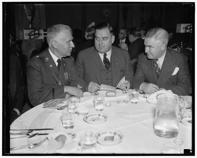 Bay State Governor and aides. Washington, D.C. Jan. 19. Governor Charles F. Hurley, (center) of Massachusettes, with his aides, Gen. Charles Cole, (left) Massachusetts Adjutant General, and John L. Delaney, as they attended the housing luncheon for state Governors today at the Mayflower Hotel