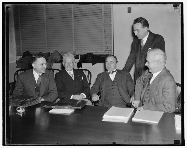 Begin study of security changes. Washington, D.C., Nov. 5. Outstanding business, industrial and labor leaders attended the first meeting of the Social Security Advisory Council today. Possible changes in the Social Security Act were discussed at the meeting which was held in the Secretary of Labor's office. Here we see, left to right: J. [?] Douglas Brown, Princeton University; Gerard Swope, President of General Electric Co.; Matthew Woll, A.F. of L.; Philip Murray, C.I.O.; as they talk to Arthur J. Altmeyer, Chairman of the Social Security Board, 11/5/37