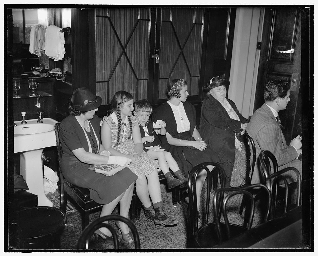 Bergdoll family at Senate Military Affairs Committee hearing. Washington, D.C., May 24. The family of Grover Cleveland Bergdoll, the World War draft dodger who fled to Germany to escape prosecution, were in the Senate Military Affairs Committee room today as Harry Weinberger, Bergdoll attorney, denounced the House approved bill designed to prevent Bergdoll from returning to the United States. At the same time Weinberger announced that Bergdoll is aboard the liner Bremen which will arrive in New York tomorrow. Bergdoll will then be surrendered to the Commanding General of the Second Corps area at Governor's Island. Left to right can be seen: Mrs. Elizabeth Hall, sister of Bergdoll, Emma, a daughter, Erwin, a son, Mrs. Grover Cleveland Bergdoll, and Mrs. Emma C. Bergdoll, the draft evader's mother