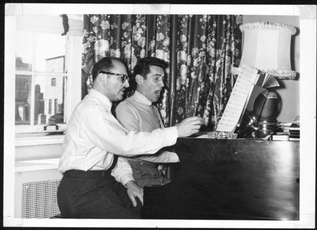 Bernstein with composer and friend Marc Blitzstein reading through the score of Kurt Weill's Three Penny Opera, June 1952. Photographer: Morris Beck. (Music Division)