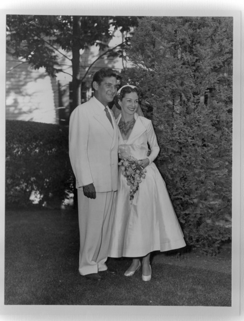 Bernstein with Felicia at their wedding. Bernstein's suit had previously belonged to Serge Koussevitzky. September 9, 1951. (Music Division)