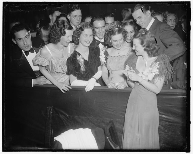 Besieged by autograph seekers. Washington, D.C., Jan. 29. Janet Gaynor, screen star was besieged by autographed seekers as she arrived to entertain the merrymakers at the president's birthday ball at the Wardman Park Hotel tonight, 1/29/38