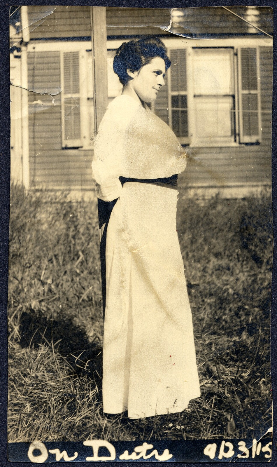 [ Bessie Fine standing next to a post in front of a house, 9/23/15]