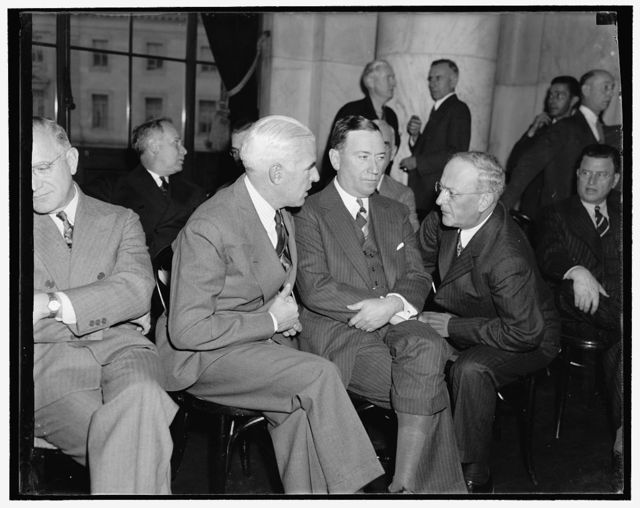Big three of U.S. Steel. Washington, D.C., Nov. 2. Interested spectators at today's session of the Monopoly Committee now investigating the $4,000,000[,000?] steel industry were, left to right: Edward R. Stettinius, Chairman of the Board, U.S. Steel Corp., Benjamin F. Fairless, President, and William Beye, Vice President
