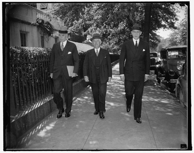 Big three on U.S. Foreign relations. Washington, D.C., Oct. 8. President Roosevelt's first act on his return to the Capital today was to call his Chief Foreign Relations advisors into a conference for a discussion of the International Situation. The big three are shown as they left the White House. Left to right: Secretary of State Cordell Hull; Norman H. Davis, Ambassador-at-large; and Sumner Welles, Undersecretary of State. 10/8/37