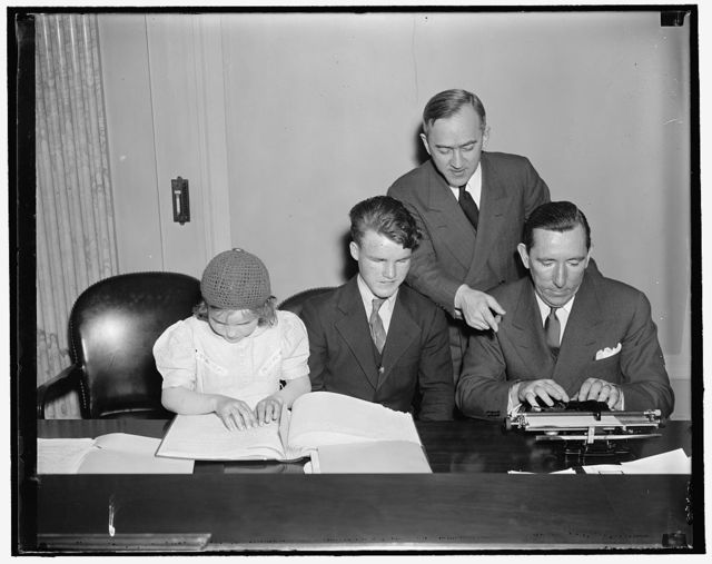 Blind youngsters display ability before Senate Committee. Washington, D.C. April 9. Blind children from the Maryland School for the Deaf, Dumb and Blind coaching Senator Claude Pepper, of Florida, in the art of operating a braille typewriter. The youngsters appeared before the senate subcommittee on education and labor, of which Senator Pepper is Chairman, as an example of what can be done for physically handicapped children if a bill sponsored by the International Society of Crippled Children is passed. The bill provides for the education of all types of physically handicapped children. It appropriates $1,158,000, of which $2,080,000 is an outright grant ($40,000 to each state), and $9,000,000 for matching; and $500,000 for administration of the act by the U.S. Office of Education. In the picture, left to right: Frances Wright, 8 years old, reading a braille book; Andrew Birmingham, 10 years old; Dr. John W. Studebaker, U.S. Commissioner of Education; [...] Claude Pepper.