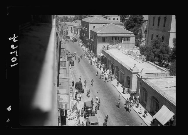 Bomb explosion in Arab café on Mamillah Road in Jerusalem, on June 30 '39, Friday a.[m.]. Mamillah Road after the explosion showing cleared area in the distance, on left where top of car was partly blown off