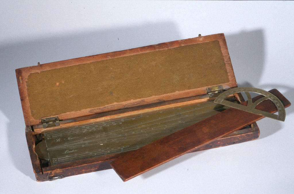 Boxed set of brass surveying tools