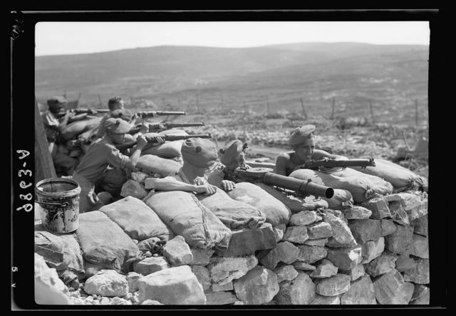 British Military Camp at klm. 41, Lubban-Nablus Rd. British troops on observation post with rifles, machine-guns & flare-lights