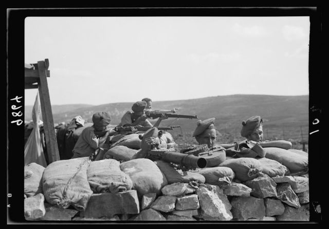 British Military Camp at klm. 41, Lubban-Nablus Rd. British troops on observation post with rifles, machine-guns & flare-lights, view looking toward Sinjel from height above Lubba[n]