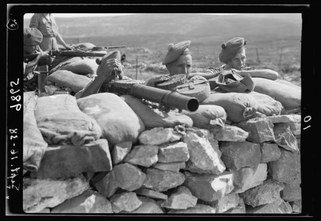 British Military Camp at klm. 41, Lubban-Nablus Rd. British troops on observation post with rifles, machine-gunes & flare-lights, close-up
