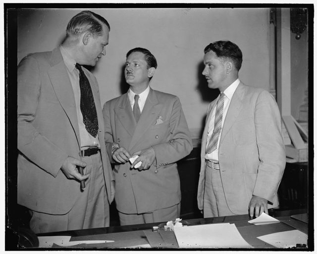 Brothers first witnesses before Congressional Committee investigating un-American activities. Washington, D.C., Aug. 12. Two brothers of Chicago, James J. (right) and John Metcalfe, (center) first witnesses before the Special House Committee investigating Un-American activities, are pictured with Rep. Martin Dies, Chairman. Both declared the German-American bund wields a powerful influence over Germans in this country. John, a former newspaper [man] but now an investigator for the committee, and James, a Chicago reporter, gained their information by joining the buned under assumed names, 8/12/38