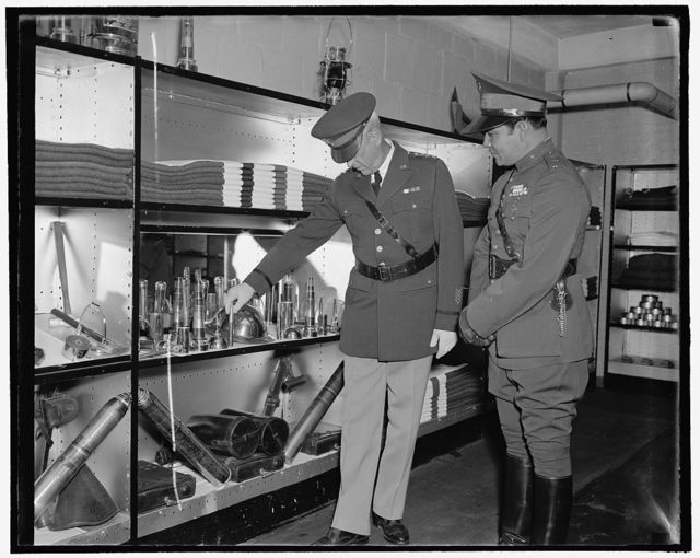 Bullets interest Cuban Dictator. Washington, D.C., Nov. 12. Shown through the World War Museum at Arlington amphitheater today, Col. Fulgencio Batista, right, Cuban Dictator, seemed particularly interested in the manu types of bullets as explained by the U.S. Chief of Staff Malin Craig, 11/12/38