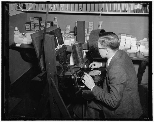 Bureau of Standards. Standardization of card colors: Kenneth Kelley judging colors of dyes