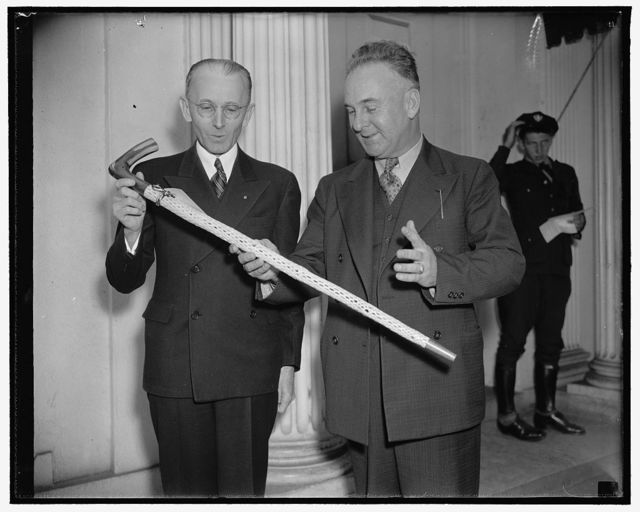 Cactus Cane gift to the President. Washington, D.C., May 16. A cane, made from Arizona Cholla Cactus, was today presented to President Roosevelt as a gift from the Disabled War Veterans in Veterans Hospital at Tucson, Arizona. Roland M. James, (left) Chairman of the Tucson Allied Veterans Committee, and Rep. John R. Murdock made the presentation for the Veterans. F3605/16/38