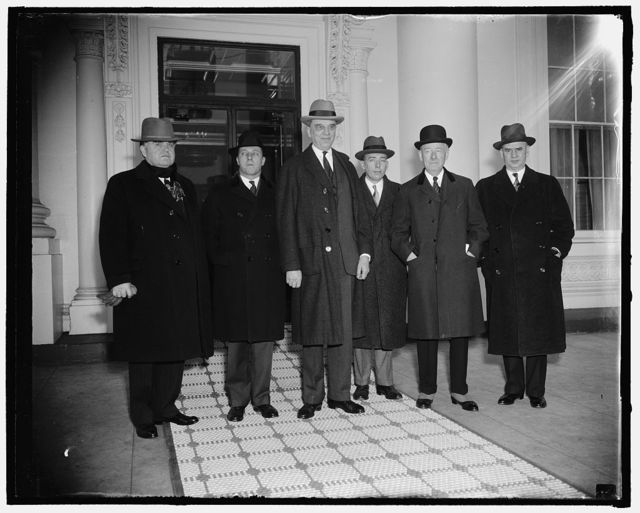 Capital and Labor at White House conference. Washington, D.C., Jan. 14. A group comprising representatives of Capital, Labor and the Erstwhile Brain Trust of the New Deal converged upon the White House today to put before the President some recommendations for pulling business out of present slump. Left to right; John L. Lewis C.I.O. leader, Charles Taussig, former Brain truster, Owen D. Young, head of the General Electric Co. A.A. Berle, former Brain truster, Thomas W. Lamont, partner of J.P. Morgan, and Philip Murray, C.I.O. leader, 1/14/38