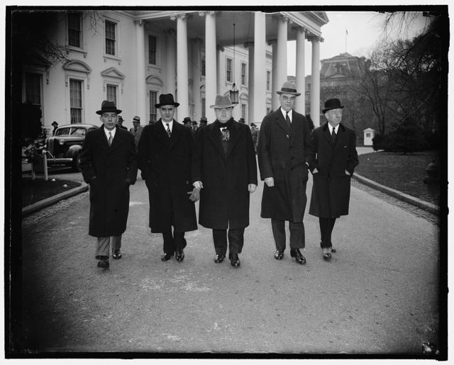 Capital and Labor leaders at White House. Washington, D.C., Jan. 14. Shown leaving the White House after a conference with President Roosevelt, where they presented some recommendations for pulling the country out of the present business slump, were left to right; A.A. Berle, former Brain truster of the New Deal, Philip Murray, C.I.O. leader, John L. Lewis, C.I.O. chief, Owen D. Young, head of the General Electric Co. and Thomas W. Lamont, partner of J.P. Morgan, 1/14/38