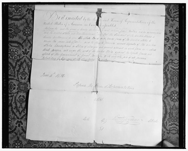Capitol 'attic' yields records of early American Congresses. Washington, D.C., Jan. 23. Historical records dating back to early American Congresses have just been found during a house-cleaning of the attics and basement of the house wing at the Capitol. 1. Above is the original House Bill written in longhand, which declared that a state of war existed between the United States and Great Britain and dependencies. Signed by Patrick Magruder, then Clerk of the House, the Bill was delivered to the Senate and returned in the form of a 'Confidential Bill' in which a change was made to read 'the United Kingdom of Great Britain and Ireland and the dependencies thereof.' The first and finished draft were believed to have been lost when the Capitol was burned in 1814, 1/23/39