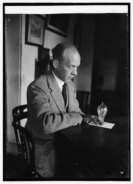 Carl. W. Mitman Curator of engineering at Smithsonian Institution with 1st cold electric light bulb, 9/6/24