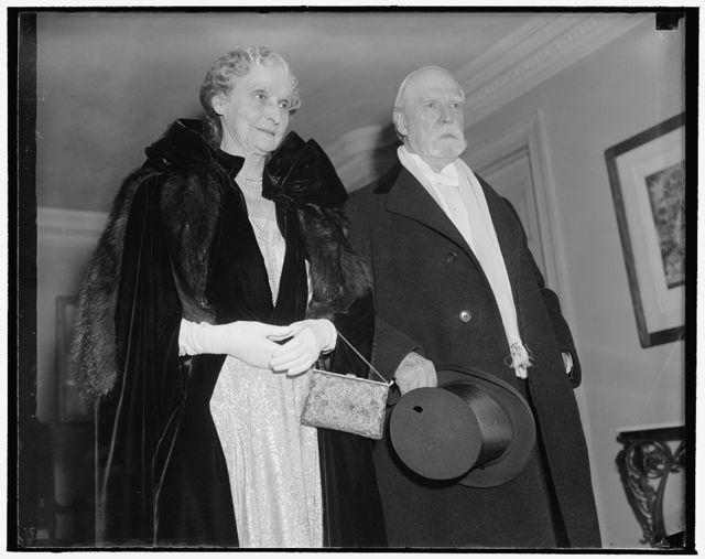 Chief Justice and Mrs. Charles Evans Hughes attend Judiciary reception at White House. Washington, D.C., Jan. 4. Chief Justice of the U.S. Supreme Court and Mrs. Charles Evans Hughes leaving their home tonight to attend the Judiciary reception at the White House