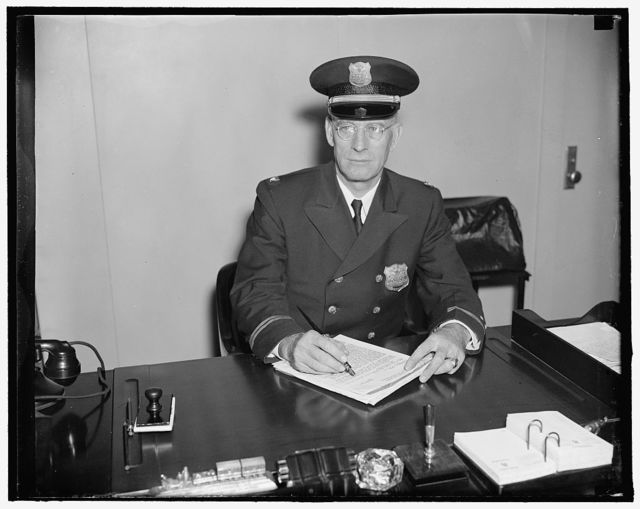 """Chief of """"Uncle Sam's police force."""" Washington, D.C., Sept. 8. World War Veteran and for 15 years in the Government Guard service, Elmber Clint Duncan has been named inspector of all the guards who watch over the federal buildings in the Capital. He will be in charge of disciplining the service's 800 men and investigating any disturbance which may arise in any of the 125 buildings under his jurisdiction. He is a native of Tennessee. 9/8/37"""