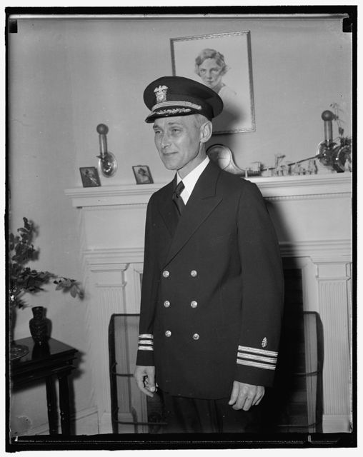 """""""Chief tooth puller for the president."""" Washington, D.C., Nov 25. Commander Arther H. Yando, Dental Corp of the U.S. Army, who has been taking of the President's dental needs and who pulled a molar for the President takes time out for a picture while leaving the White House. 11/25/37"""