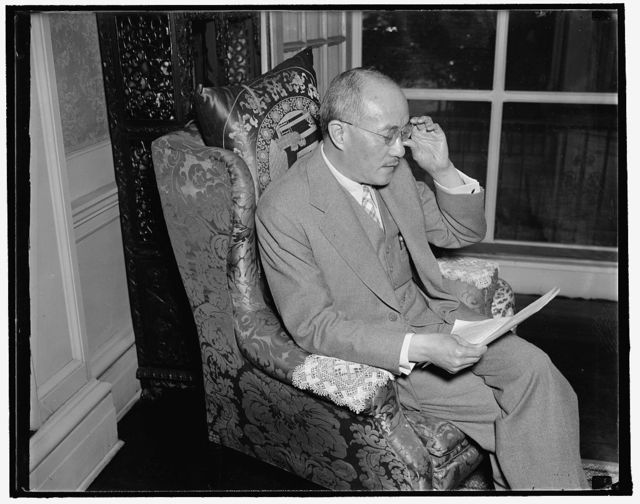 """Chinese ambassador gives latest war news to newspapermen. Washington, D.C., Sept. 25. Dr. C.T. Wang, Chinese Ambassador to the United States, reading to newsmen today a statement in which he charged that the Japanese Army in China has placed itself """"beyond the pale of humanity"""" by indiscriminate bombing of civilian areas, destruction of Chinese Red Cross units an the use of poison gas. The Ambassador seemed deeply upset as he read the prepared statement. 9/25/37"""