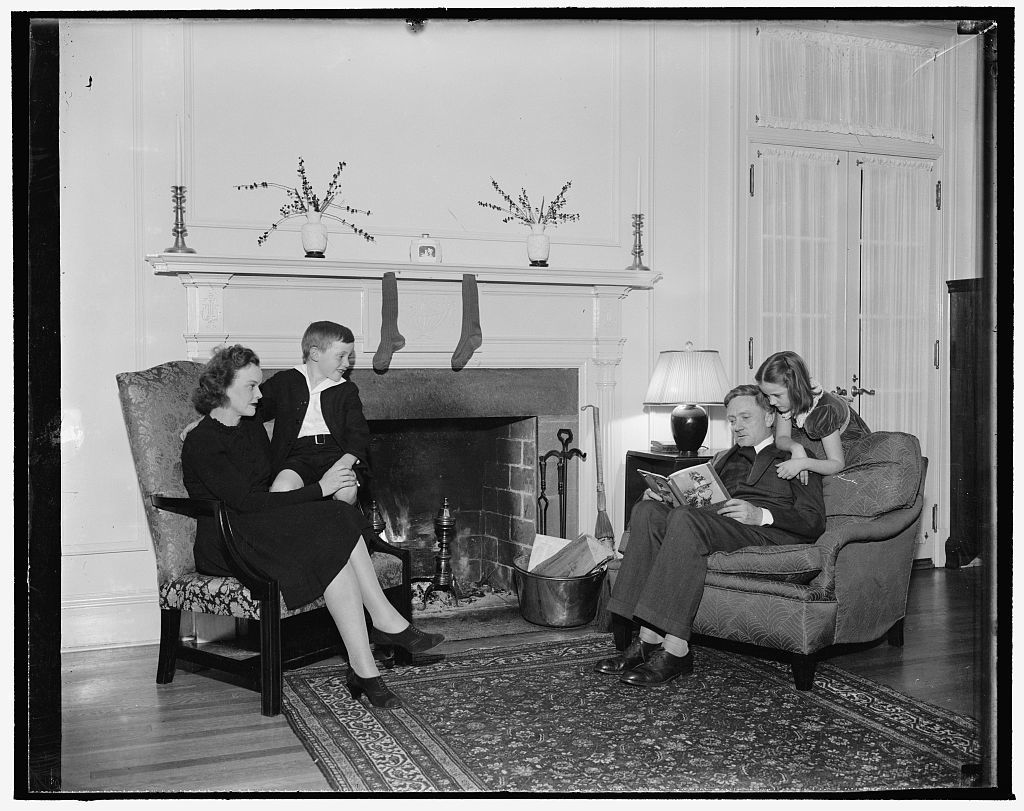 Christmas Eve at home of youngest Supreme Court Justice. Washington, D.C., Dec. 18. Associate Justice of the Supreme Court and Mrs. William O. Douglas with their children, Mildred Riddle, and William O., Jr., will reenact this scene at their home on Christmas Eve