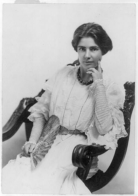 [Clara Clemens, 1874-1962, three-quarter length portrait, seated,facing left]