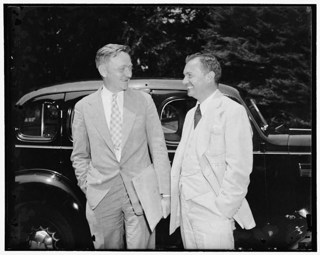 Confer with President on anti-trust matters. Washington, D.C., June 24. William O. Douglas, Chairman of the Securities and Exchange Commission. Left; and Robert Jackson, Solicitor General, photographed after leaving the White House today where they conferred with the President on anti-trust matters, preliminary to the government inquiry into monopolistic business practices, 6/24/38