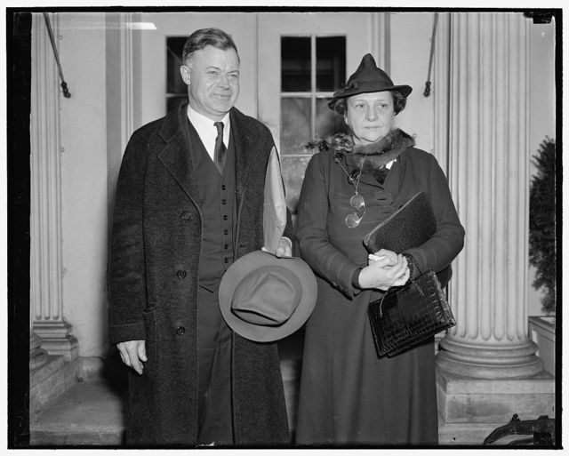 Confer with president. Washington, D.C., Dec. 6. Chairman J. Warren Madden of the National Labor Relations Board and Secretary of Labor Frances Perkins leaving the White [House][?] after discussing with President Roosevelt a labor dispute at the Merrimac Mills at Huntsville, Ala., which the Labor Secretary said was settled last night