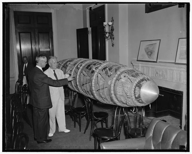 Congress sees model of new proposed American-designed dirigible. Washington, D.C. June 9. Rep. Edward A. Kenney, (right) of New Jersey, Chairman of the House Interstate Commerce Committee, viewing a model of a new american designed dirigible displayed at the Capitol today. Roland B. Respess, President of the Respess Aeronautical Engineering Corp., is pointing out the features of the ship to the House member. The House Interstate Subcommittee is hearing the witness on a bill recently introducted to authorize the loan of $12,000,000 for constructing two eight-million-cubic-foot dirigible airships, a large american airship plane, and Atlantic operating terminal with a veiw toward establishing twice-a-week American Transatlantic airship service. 6/9/37