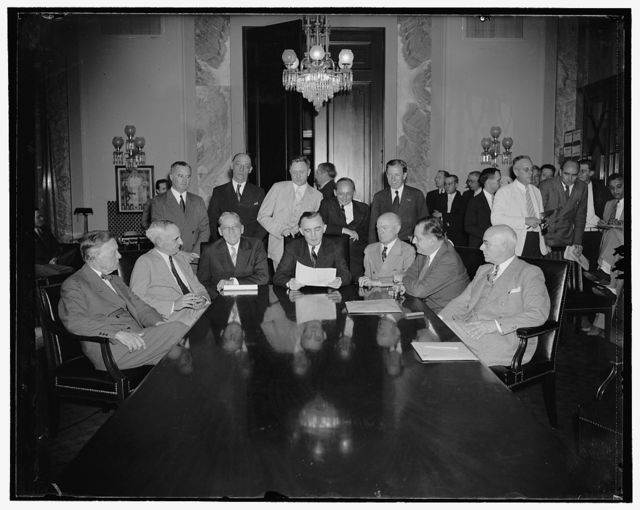 Congressional monopoly committee holds initial meeting. Washington, D.C., July 1. The Congressional Executive Committee to investigate monopolies held their first meeting today and charted a course designed to determine the efffect of concentrated wealth and power on business. Pictured, left to right: (sitting) Senator William E. Borah, Herman Oliphant, General Counsel for Treasury; Senator William H. King, Utah; Senator Hoseph C. O'Mahoney, of Wyoming and Chairman of the Committee; Rep. Hatton W. Sumners, of Texas and Vice Chairman; Thurman Arnold, Assistant Attorney General; and Rep. Edward C. Eicher of Iowa. Standing left to right: Richard C. Patterson, Jr., Assistant Secretary of Commerce; Garland S. Ferguson, Chairman of Federal Trade Commission; William O. Douglas, Chairman of S.E.C.; Isador Lubin Chief of Bureau of Labor Statistics, Department of Labor; and Rep. Edward H. Rees of Kansas, 7/1/38