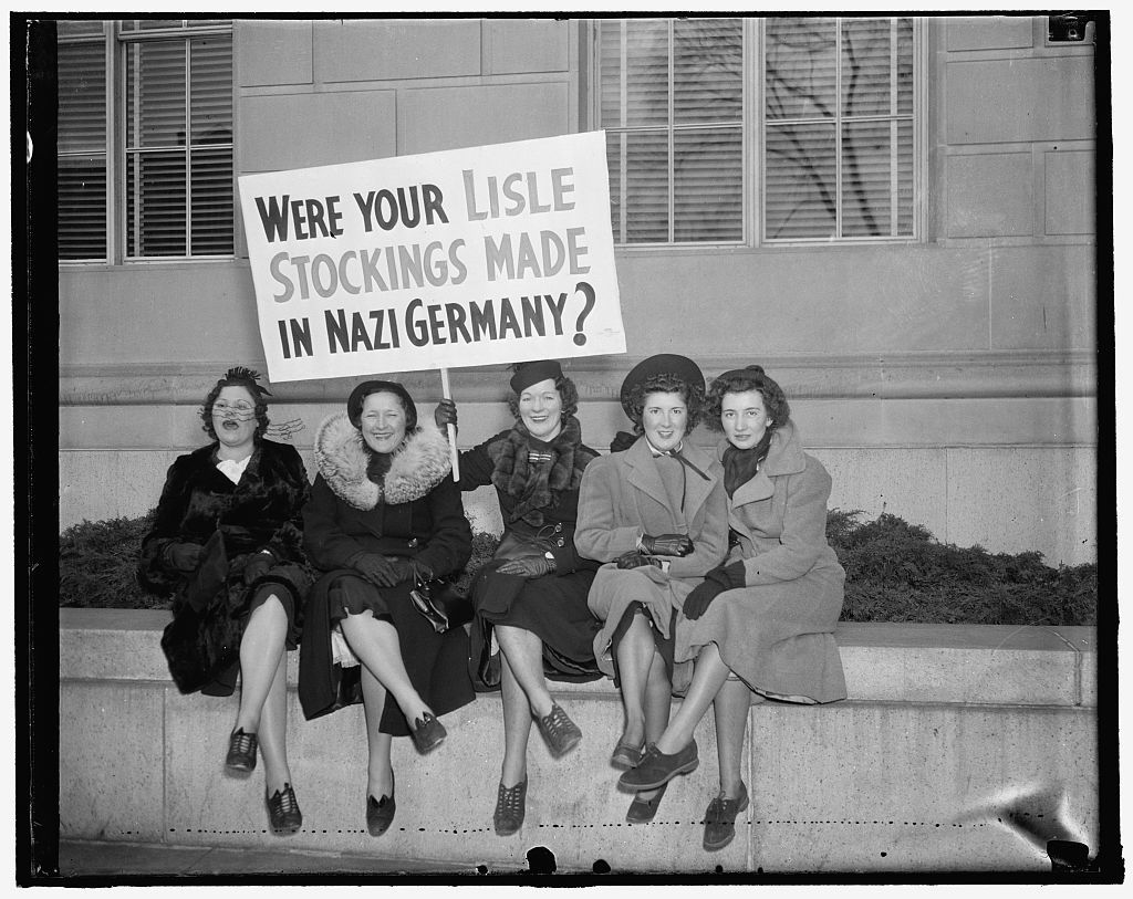 Convincing argument. Washington, D.C., Jan. 28. These girls, members of the delegation of three hundred hosiery workers from Philadelphia who paraded to the White House today in protest against the Japanese Silk boycott present a convincing argument on why women should continue to wear silk hose, 1/28/38