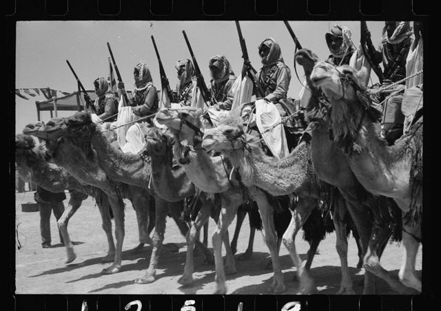 Coronation of King Abdullah in Amman on May 25, '46. Cavalry of the Arab Legion in march past parade