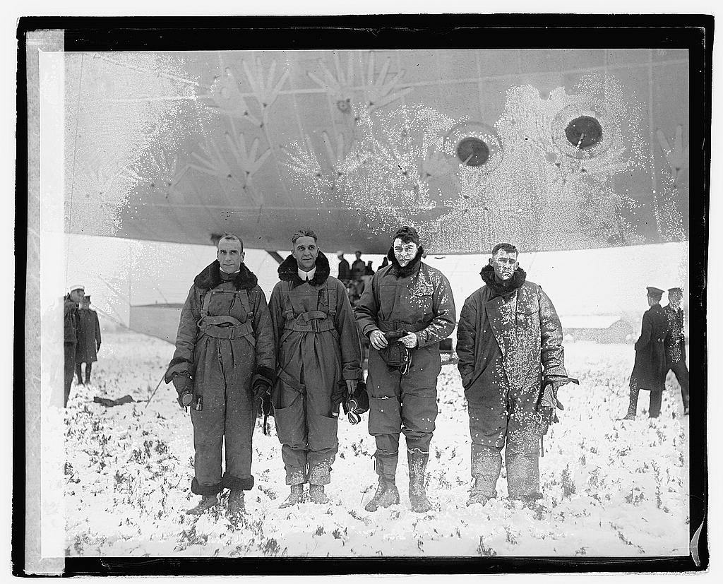 Crew of the Navy C-7 photographed on their arrival in Washington this morning. Left to Right: Lt. Commander Zachary Lansdowne, (in command) Lt. Com. R.F. Wood, Lt. A.T. Sewell, Chief Machinist, G.C. Ferris, 12/5/21