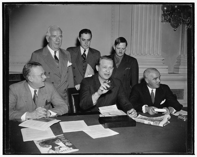 Curtain for Dies Committee. Washington, D.C., Dec. 15. Probably the most criticized congressional investigation in many years came to an end today when Chairman Martin Dies brought down his gavel to signalize the House Committee Investigating Un-American Activities is adjourned. Pictured as the final hearing closed are, left to right, seated: Rep. Harold G. Mosier, Ohio-Chairman Martin Dies. and Rep. J. Parnell Thomas of New Jersey. Standing, left to right: Rep. John J. Dempsey of New Mexico; Ree. Stripling, Secretary to the committee, and John Metcalf, Chief Investigator, 12/18/38