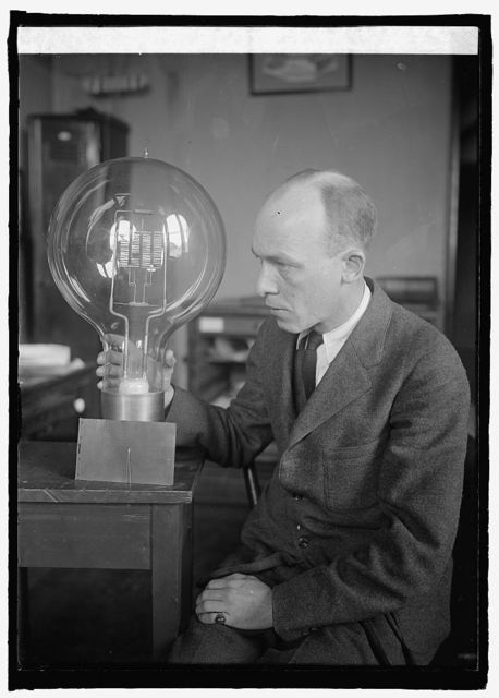 C.W. Mitman of Smithsonian Institute with giant and midget bulbs, 3/12/25