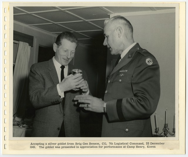 [ Danny Kaye] accepting a silver goblet from Brig Gen Benson, CG, 7th Logistical Command, 22 December 1961.