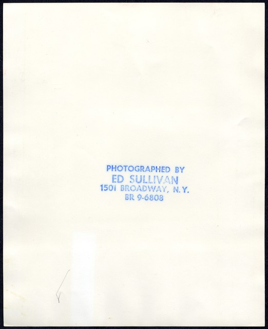 [ Danny Kaye and Sherrill Corwin (?) holding the 1972 Humanitarian Award by the Variety Cubs International]