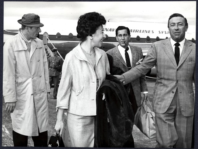 """[ Danny Kaye and Sylvia Fine arriving at London Airport. For the European premiere of """"The Five Pennies""""]"""