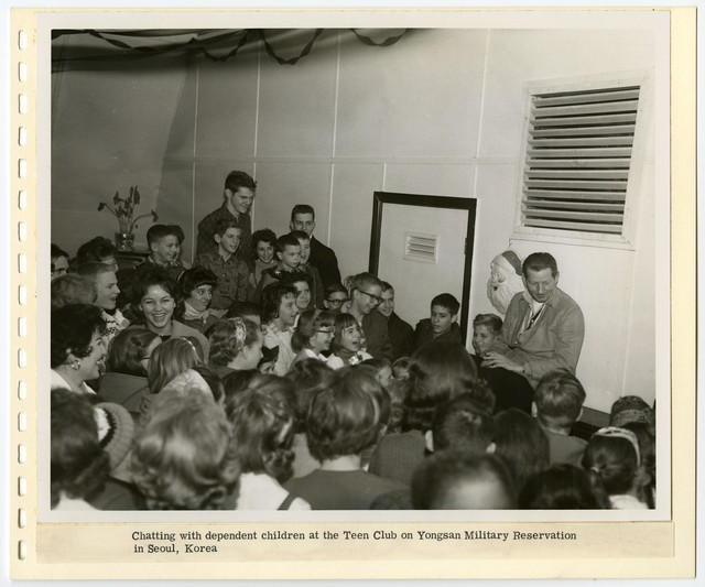 [ Danny Kaye] chatting with dependent children at the Teen Club on Yongsan Military Reservation in Seoul, Korea