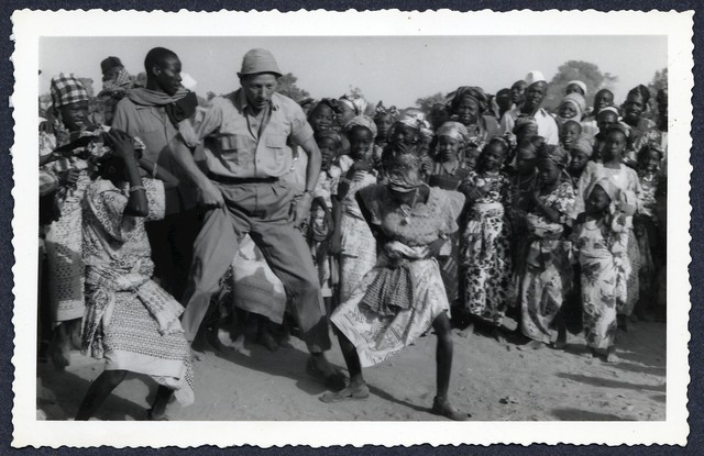 [ Danny Kaye dancing with unknown woman in Africa during a UNICEF tour]