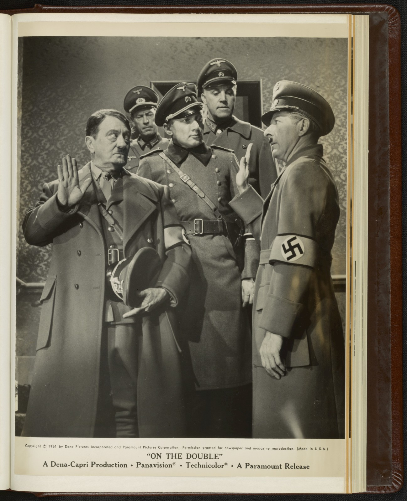 """[ Danny Kaye dressed as Hitler salutes Hitler (Bobby Watson) while escaping from Nazi soldiers in a scene from """"On the Double""""]"""