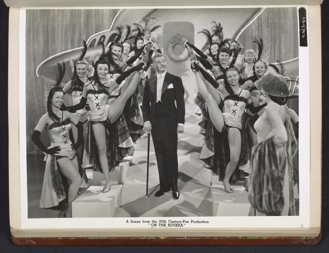 "[ Danny Kaye in theatrical impersonation of the character Henri Duran, with chorus - scene from ""On the Riviera""]"